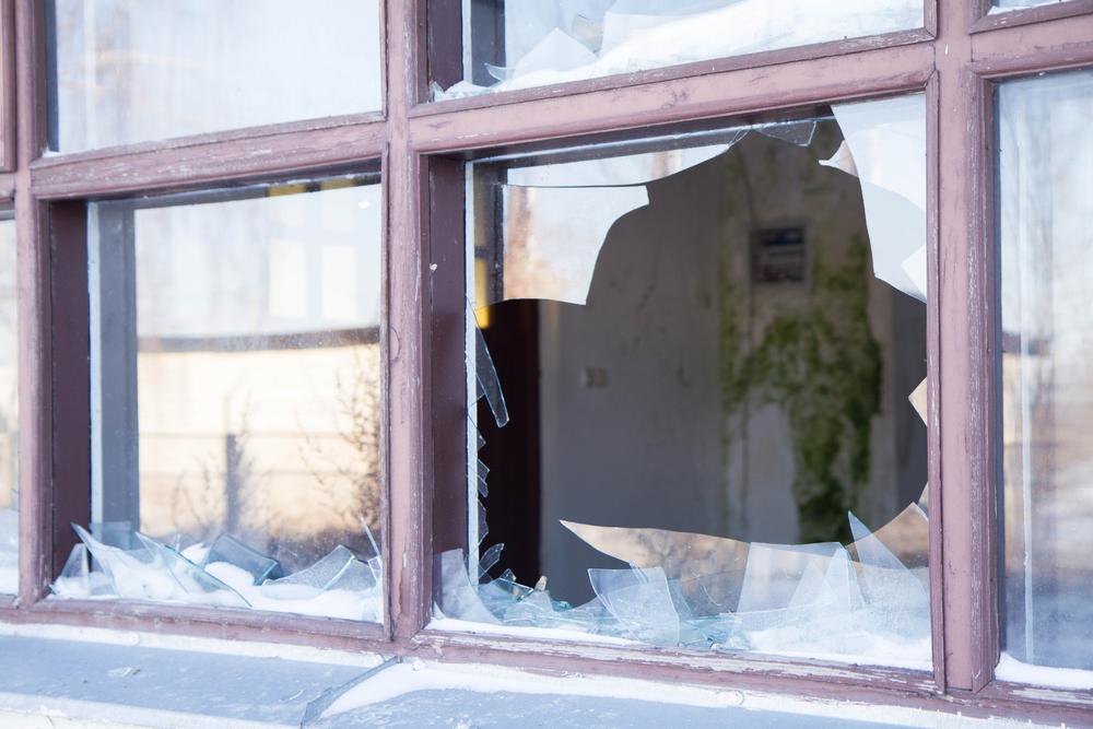 Broken window most likely because of vandalism.