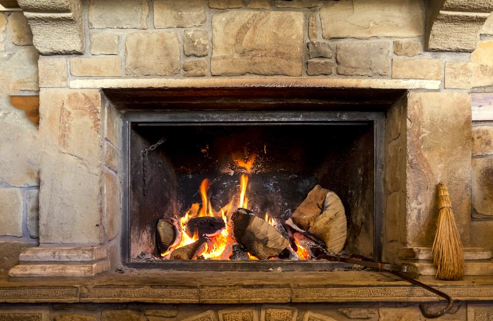 Fire lit in a fireplace.