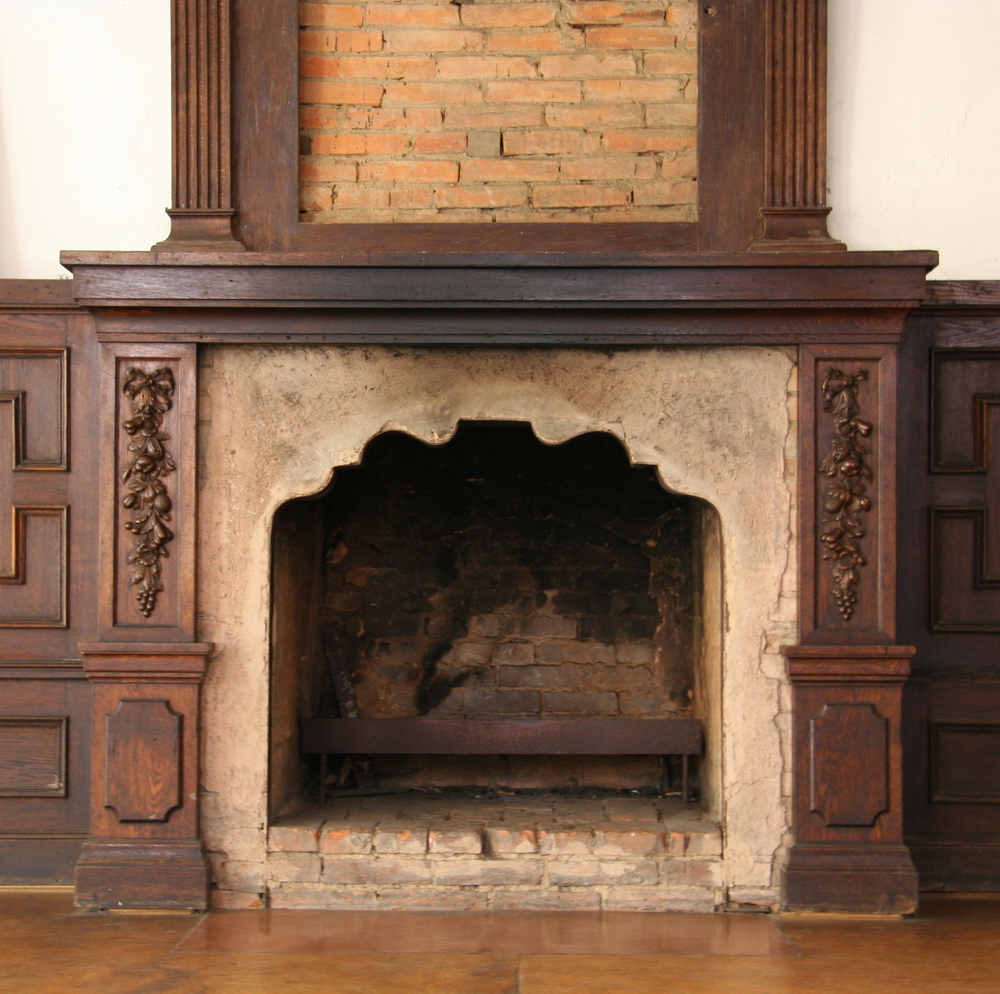 Old fire place with scorch marks in the back.