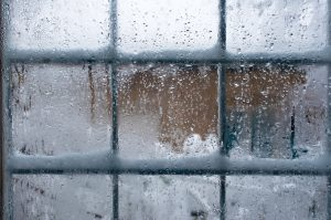 A window covered in snow and ice.