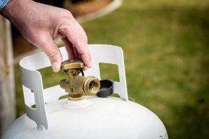 A brass valve on a propane tank.