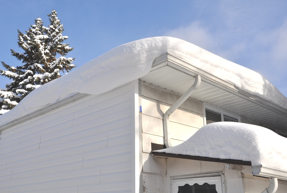 roof of a white house covered in snow