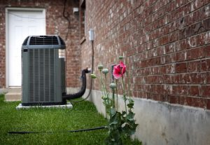 An air conditioner unit next to a house.