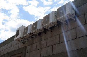 A series of evaporative coolers on the side of a building.