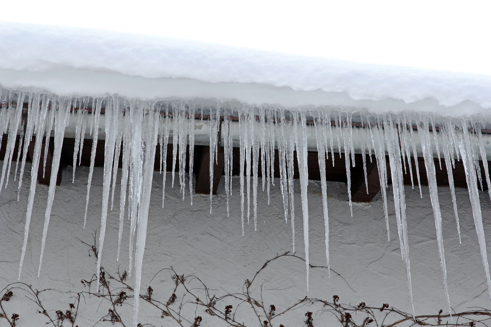 Big icicles hanging from a roof that could be an indication of an ice dam.
