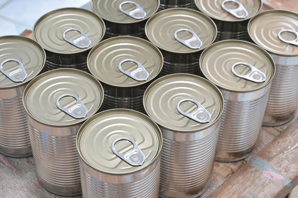 A set of sealed metal cans.