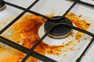 Grease surrounding a stove burner