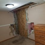 The inside of a home that's been boarded up to be repaired.