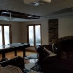 A home that's been flooded with the ceiling coming down.