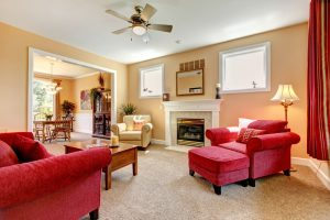 The interior of a living room with carpeted floors.