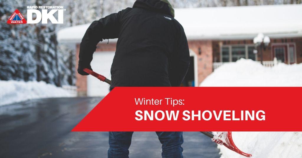 Man shoveling snow off his driveway