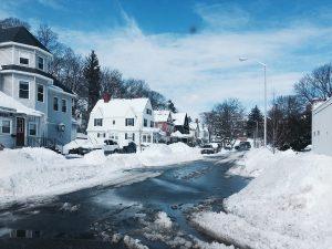 A snowy neighborhood street
