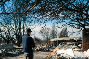 guy looking at his property destroyed by a fire